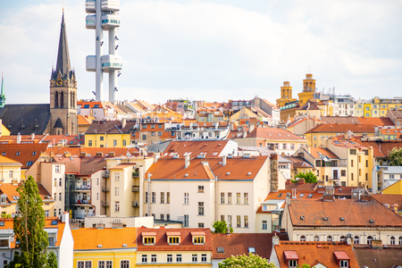 View from the top of the Vitkov Memorial on the Prague landscape on a sunny day with the famous Zizkov TV tower on the horizon Stock Photo