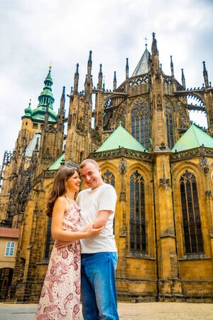 Young couple walking in old town of Prague, Czech Republic