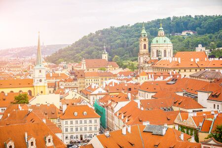 Top view to red roofs skyline of Prague city in sunset time, Czech Republic