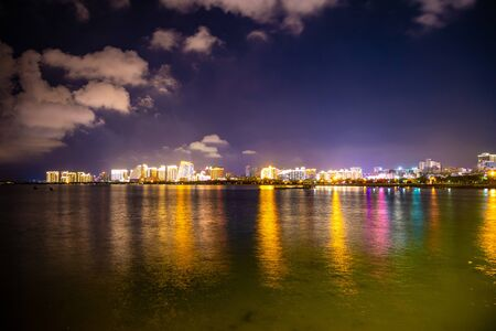 Night view of Sanya with lights reflection in the sea, Hainan in China