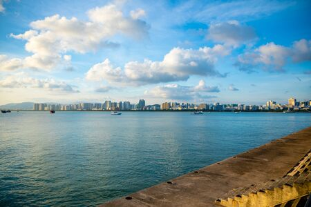 Sanya town evening cityscape, view from Phoenix island on Hainan Island in China Stock Photo