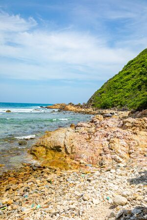 Wild beach without people next to Sanya bay in Hainan, China Stock Photo