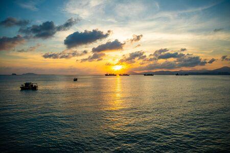 Fishing boats on sea in sunset lights in Sanya, Hainan in China Stock Photo