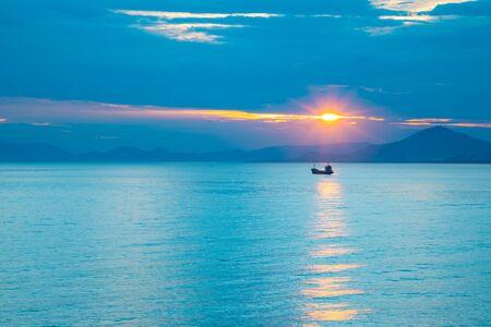 Fishing boat on sea in sunset lights in Sanya, Hainan in China