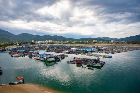 A fishing village of fishermans on the sea water in island Hainan, China Stok Fotoğraf