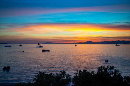 Fishing boats on sea in sunset lights in Sanya, Hainan in China Stok Fotoğraf