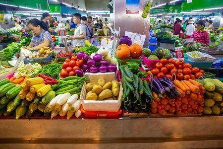 Sanya, Hainan, China - 09.07.2019: Fresh vegetables and fruits at local market in Sanya, Hainan province, China