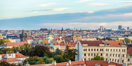 Panorama view of Prague city with red roofs and cathedral in sunset time, autumn time in Prague, Czech Republic