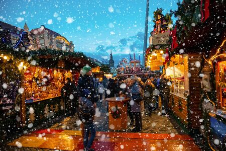 Dresden, Germany - 9.12.2018: People visit Christmas Market Striezelmarkt in Dresden in Germany