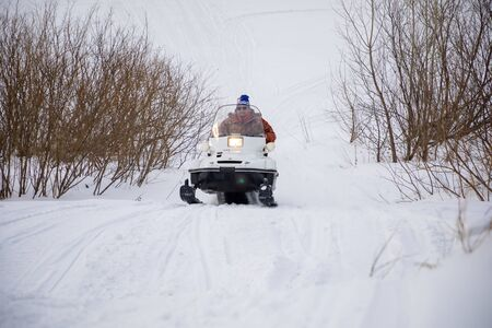 Kemerovo, Russia - 23.02.2019: Rider on the snowmobile in nature of Siberia in Russia 新聞圖片