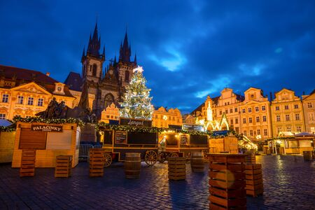 Prague, Czech Republic - 3.12.2019: Christmas market with Christmas tree on the Old Town square in Prague at early morning when all stands are still closed, Czech Republic