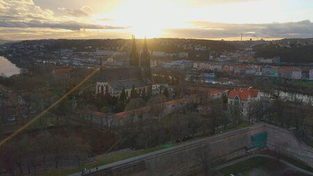 Aerial view of Vesehrad over river Vltava at sunset light in winter time, Prague, Czech republic