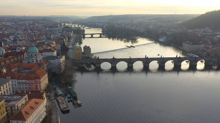 Aerial view of Charles Bridge at sunset light in desember Prague, Czech Republic