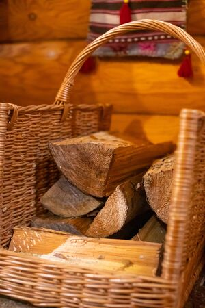 Basket with firewood on wooden background, russian bathhouse 版權商用圖片