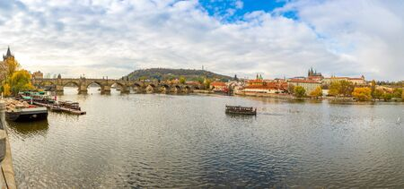Panorama view of Prague Castle and Charles bridge over river Vltava in november day in Prague, Czech Republic