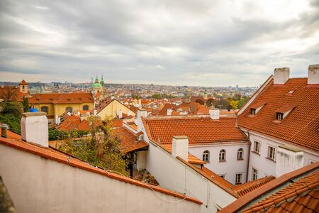 View of Prague red roofs from Prague Castle in cloudy day in Prague in Czech Republic