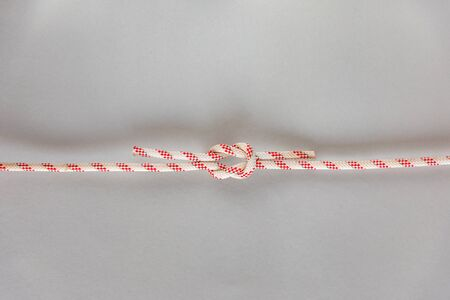 Square or reef ship knot on grey background, boating knot
