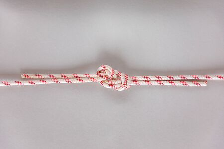 Figure eight Bend or Flemish Bend ship knot on grey background, boating knot Banco de Imagens