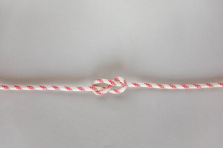 Figure eight Bend ship knot on grey background, boating knot Banco de Imagens