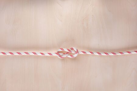 Figure eight Bend ship knot on wooden background, boating knot