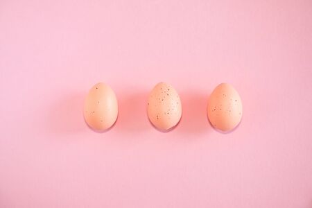Pink easter eggs on pink background with text copy space