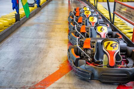 Row of karts with approval yellow numbers, ready to start inside a open track circuit, Prague, Czech Republic
