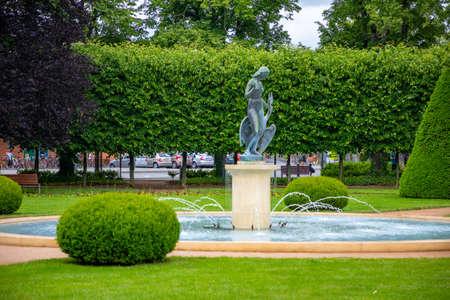 Podebrady, Czech republic - 7.06.2020: Leda with swan and park promenade, spa town Podebrady in Central Bohemia, Czech republic
