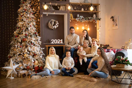 Multi Generation Family near Christmas tree in modern decorated home, Happy New year 2021