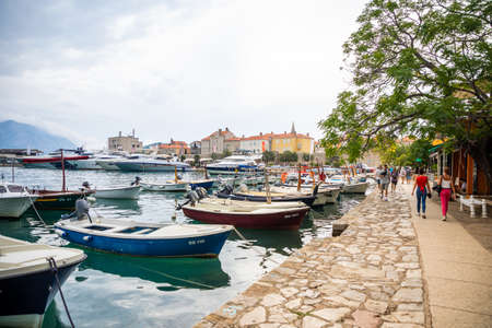 Montenegro, Budva - September 20, 2021: Marina for sailing yachts and boats overlooking the old town off the coast of Budva, Montenegro