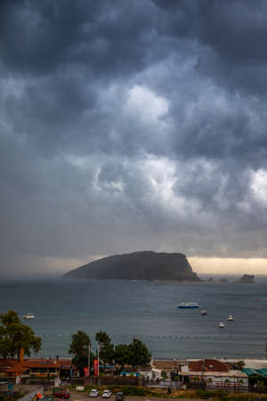 St. Nicholas island at cloudy and stormy weather in Montenegro