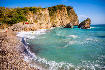 The beach and the cliffs on the island of St. Nicholas in Budva, Montenegro. Paradise beach on an island in the sea