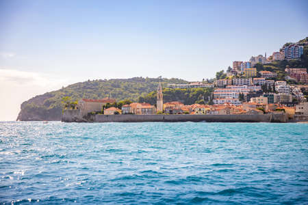 View from water of the old town of Budva city in Montenegro, view from island of St. Nicholas