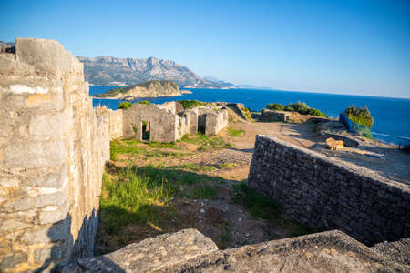 Ruins of medieval fortress Tvrdava Mogren at the shore of Adriatic sea, Montenegro.