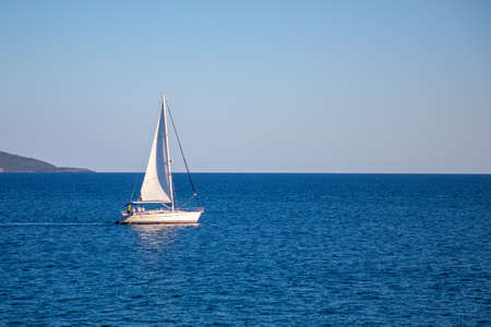 View of small yacht boat sailing in calm open sea in Montenegro Reklamní fotografie