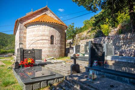 Podostrog, Budva - September 23, 2021: Church of St. John the Theologian and cemetery near, Podostrog, Budva, Montenegro