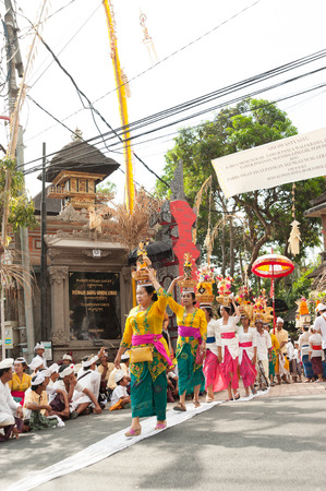 local festivals: Balinese carry the offering on their head for the Full moon ceremony in Ubud,Bali