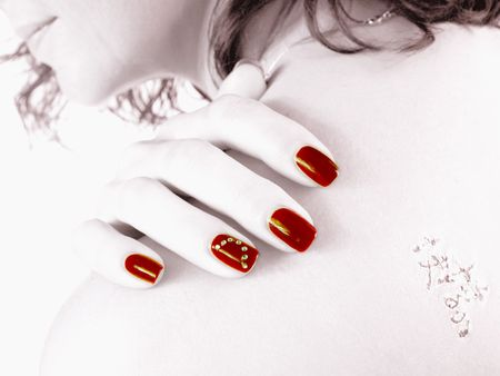 red finger nails at the back with tattoo - HighKey Stock Photo - 4817743