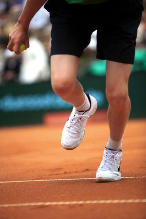 picks: A tennis boy picks up a ball during a match