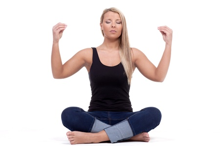 mediate: A young lady during her yoga training session. Stock Photo