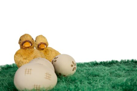 Painted easter eggs on green grass and yellow ducks photo