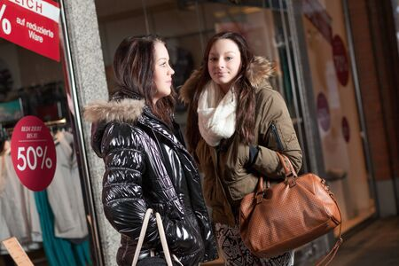 urban scene with two young women shopping in front of stores Stock Photo - 18353426