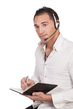 Male call center agent with headphone and holding a black notebook photo