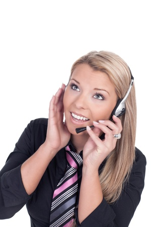 Female call center agent talking through her headphone photo