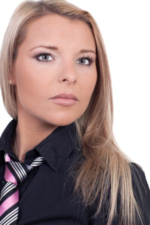 Young blonde woman looking at the camera in a serious portrait photo