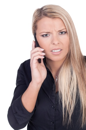 Worried young blond long haired woman talking on mobile phone, portrait photo