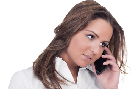 Close-up of a pensive, dark haired girl on phone photo