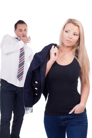 unsolicited: Man giving an unsolicited wolf whistle of appreciation as he admires the figure of a shapely blonde woman from behind, isolated on white