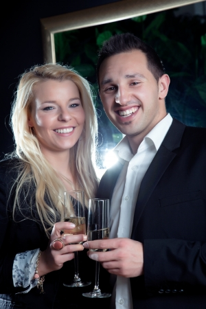 assignation: Evening portrait of a joyful romantic young couple with beaming smiles