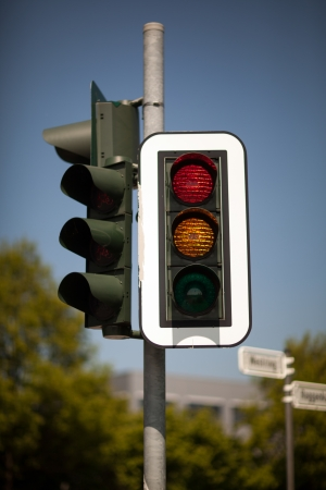 symbolization: Set of traffic lights showing red and amber for get ready