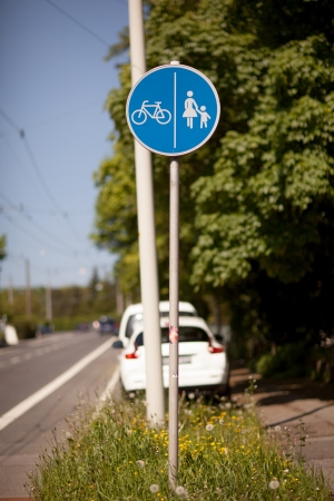 symbolization: European style footpath and cycling road sign at roadside